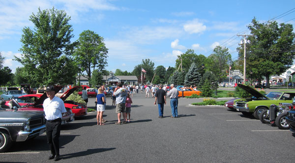 Overall view of the car show looking back at Kringle Kandle Company.