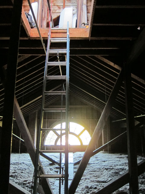 Ladder from attic space above the second floor theater to the cupola opening.