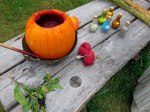 Making dye in a pumpkin.