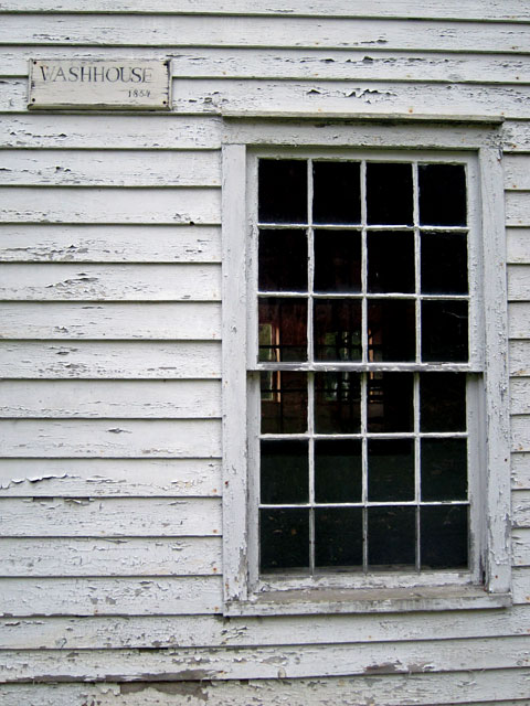 "The unrestored ""wash house."""