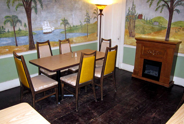 Shame on those chairs and the faux fireplace. But the murals are wonderful, and valuable.