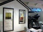 Tourist Cabin with 1939 Ford parked alongside