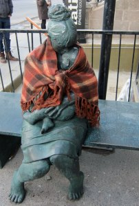 Even a statue can get cold, and a kind soul add a shawl to warm it.