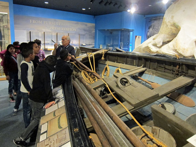 Docent explaining how the whale boat is used.