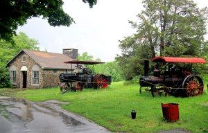 I love steam traction machines. To the left is the early school house.
