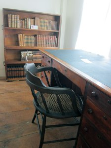 Note handles on bookcases. They belonged to Thoreau as did the desk.
