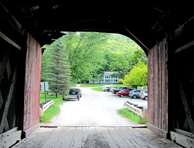 Looking through the West Arlington, Vermont, covered bridge to Norman Rockwell's home.