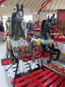 Note mechanisms under horses to rock them.