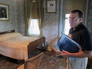 """Kevin is holding an illustration of the """"bed"""" which actually folds out from a cabinet."""