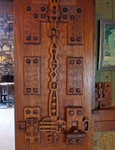 One of 47 unique hand carved doors