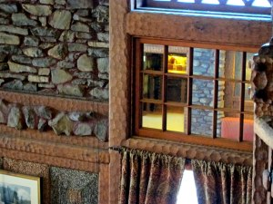 Mirrors to watch the bar from outside his bedroom
