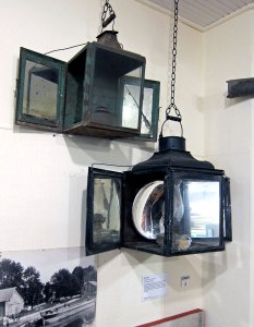 Canal boat headlights. NEVER BEFORE have I seen mirrored doors that opened to magnify the light.