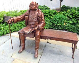 """Martin Van Buren on bench """"downtown"""". I wanted my picture take with him, but no one was around. Also would not want my camera to be a """"European Vacation Victim."""""""