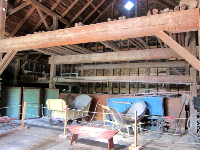 Dutch Barn (with exhibits) at The Bronck Museum. Note massive H patter supporting beam structure.