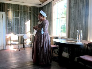 Our hostess provides history. It was decided to use new metal lathe in the restoration of this front parlor.