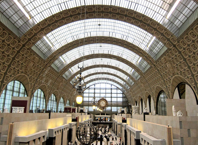 The grand entrance hall (former railroad shed) of Musee d'Orsay.