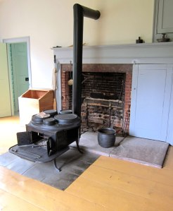 NEVER have I seen a stove like this. Small firebox in front, you can see oven door on the right, and a revolving top with removable lids to allow pots to be placed in. AMAZING